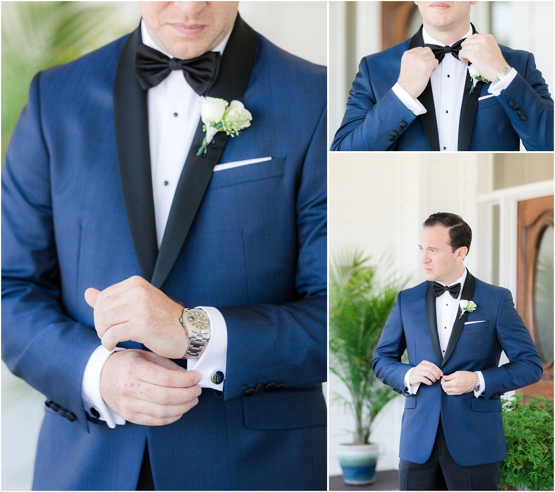 Groom getting ready in Blue Ted Baker tux jacket