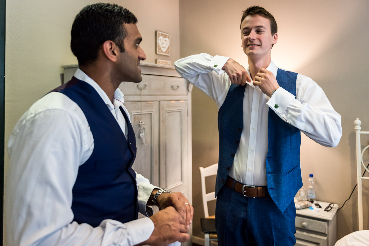 groom with his best men is getting ready