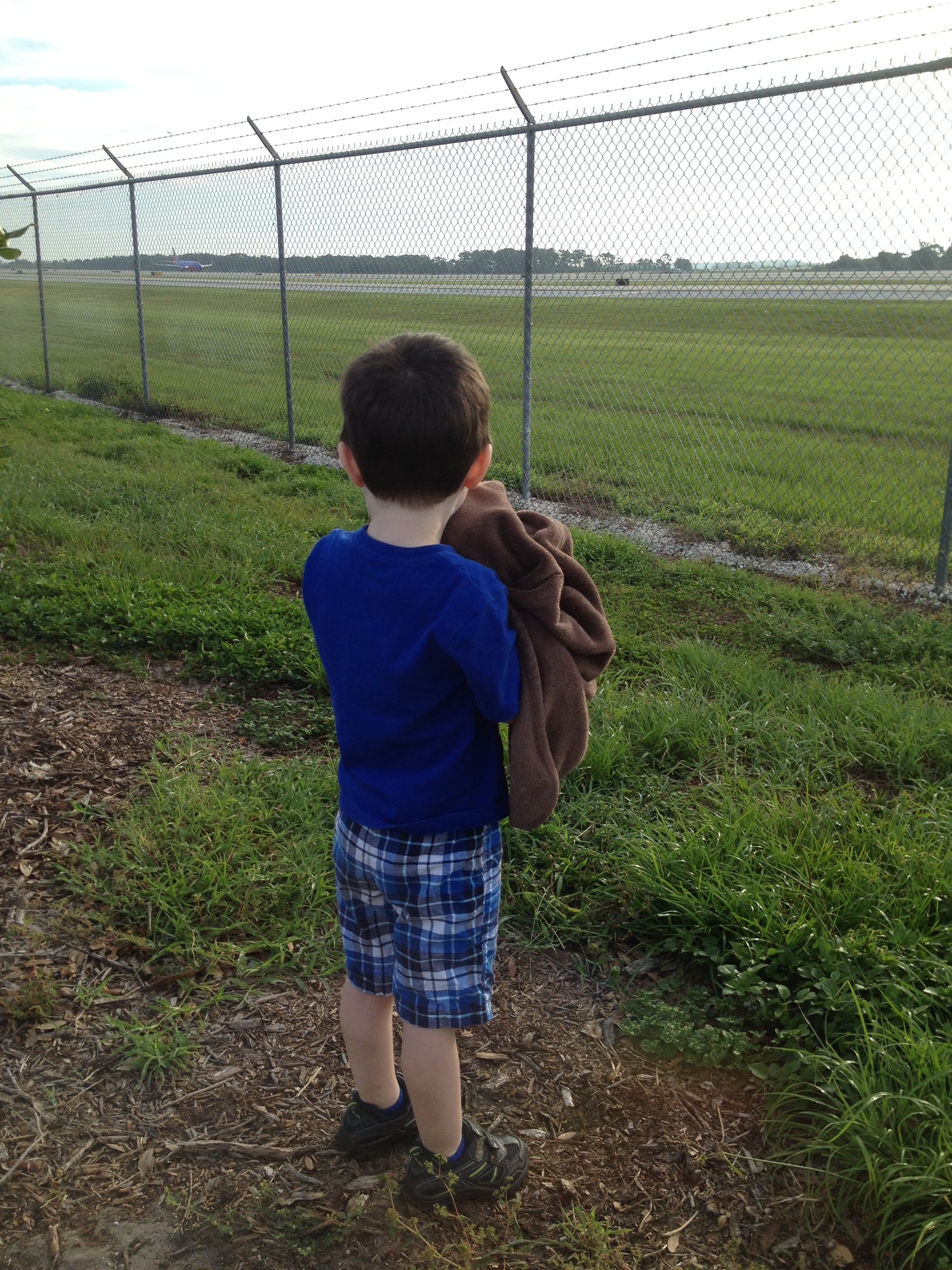 Not Mommy's airplane in the background; Jacob looking on