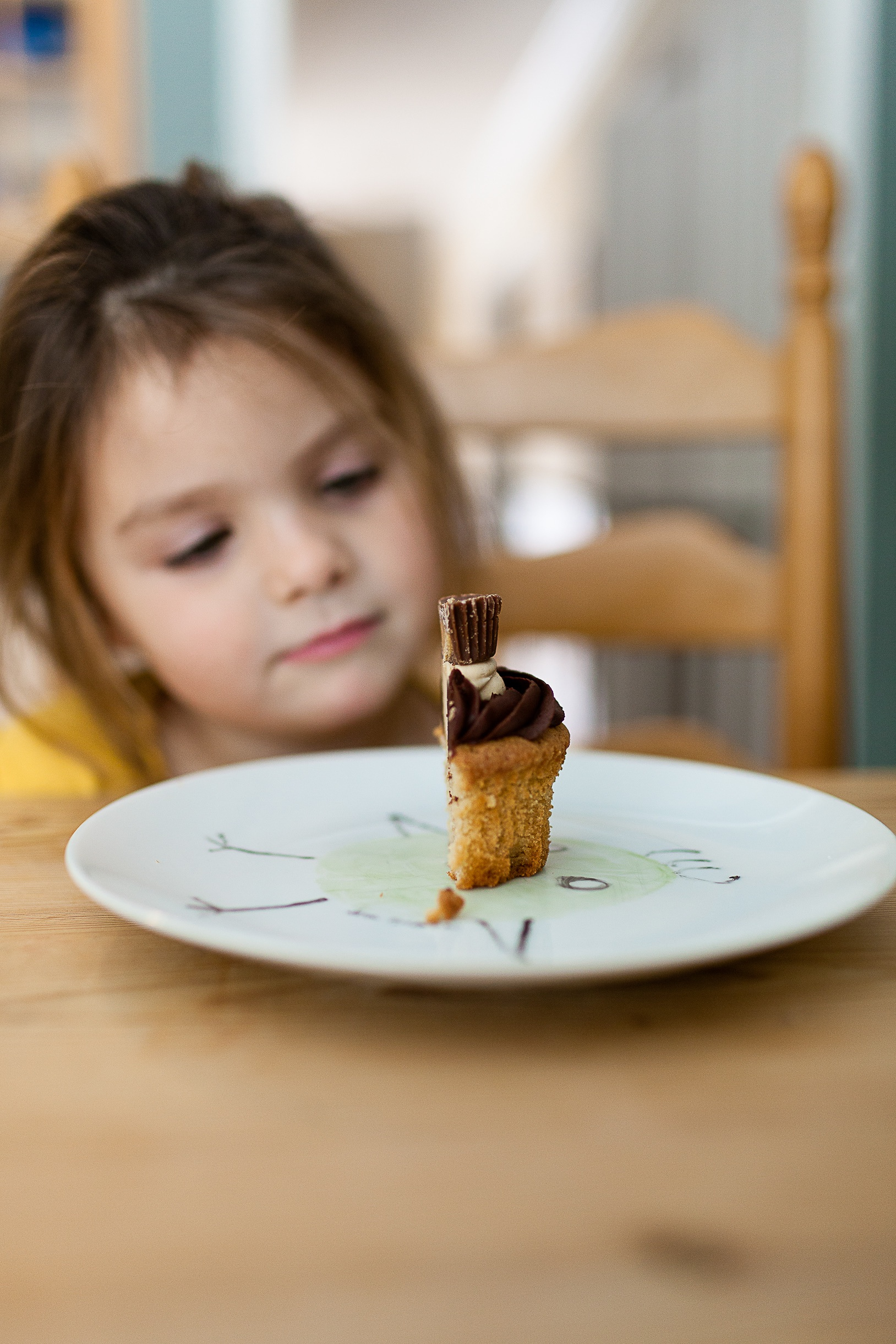 Not my kid. But she wants to know why is there only half a cupcake? And what is that icky stuff? And she doesn't like that kind! (Photo Credit: Danielle MacInnes, Unsplash.com)