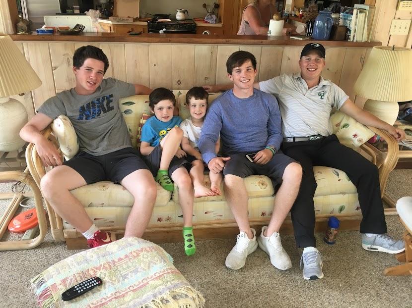 Boy cousins on couch.JPG