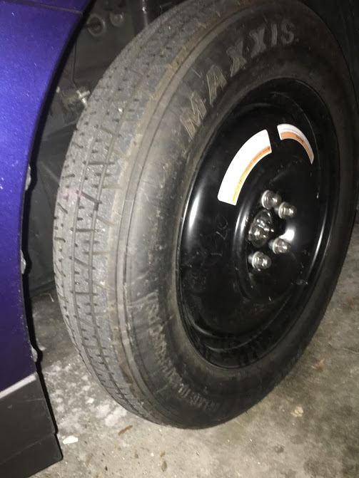 This is the spare tire on the car, which I took a picture of while the car was in the garage so I would have a picture to share with this story