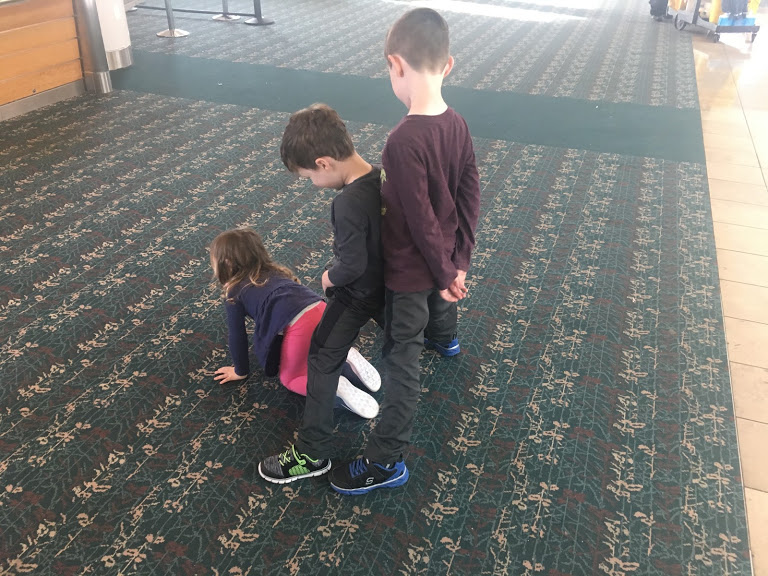 Three kids in airport.JPG