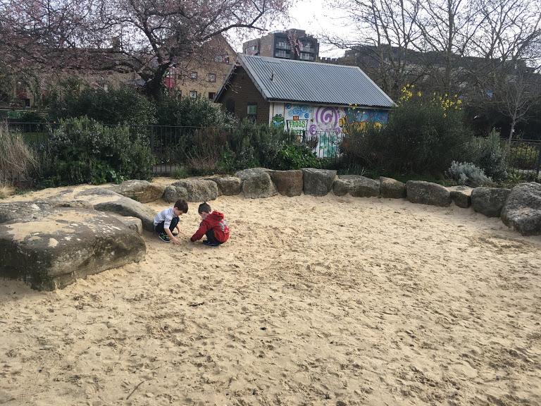 Boys in sand pit London.JPG