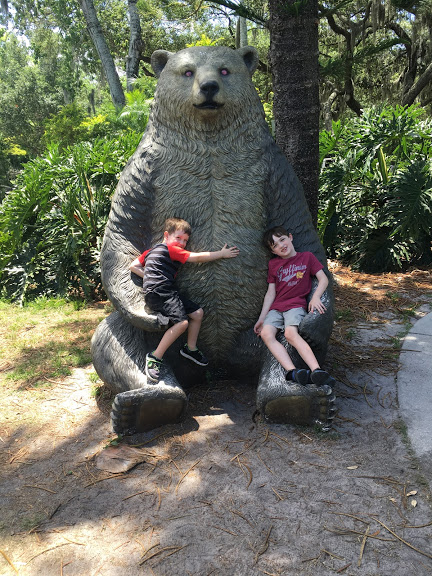 Boys with bear statue.JPG