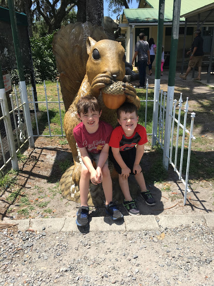 Boys with squirrel statue.JPG