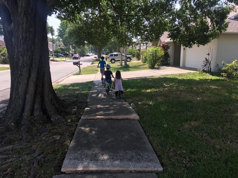 Kids bike riding sidewalk.JPG
