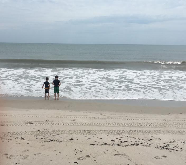 Boys by ocean.JPG