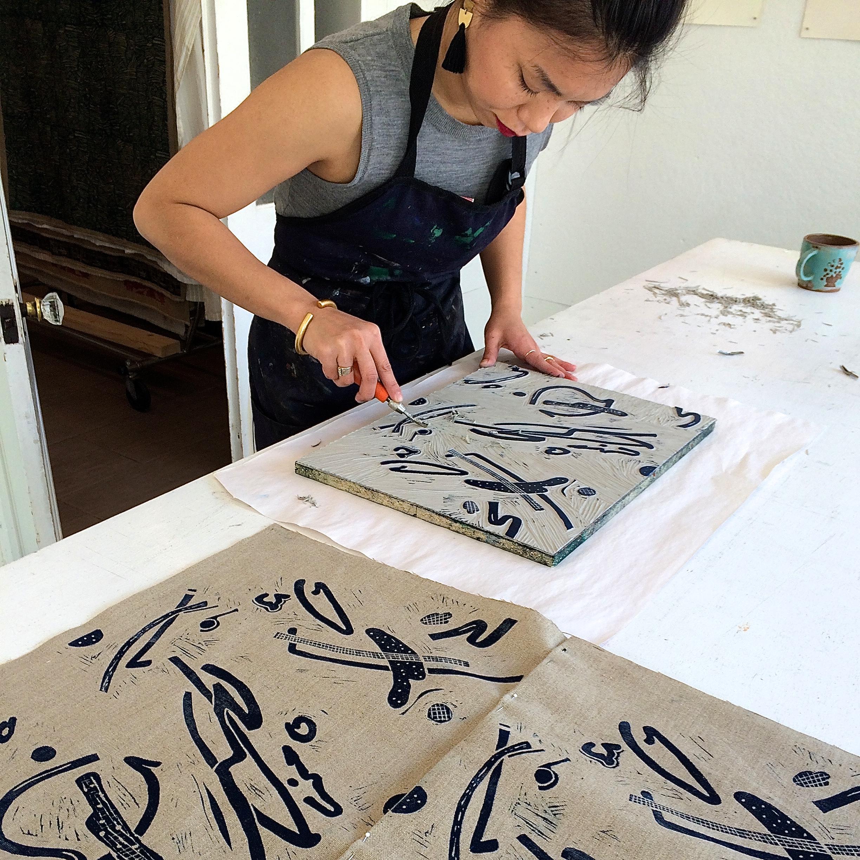 Mylene Pionilla carving her block