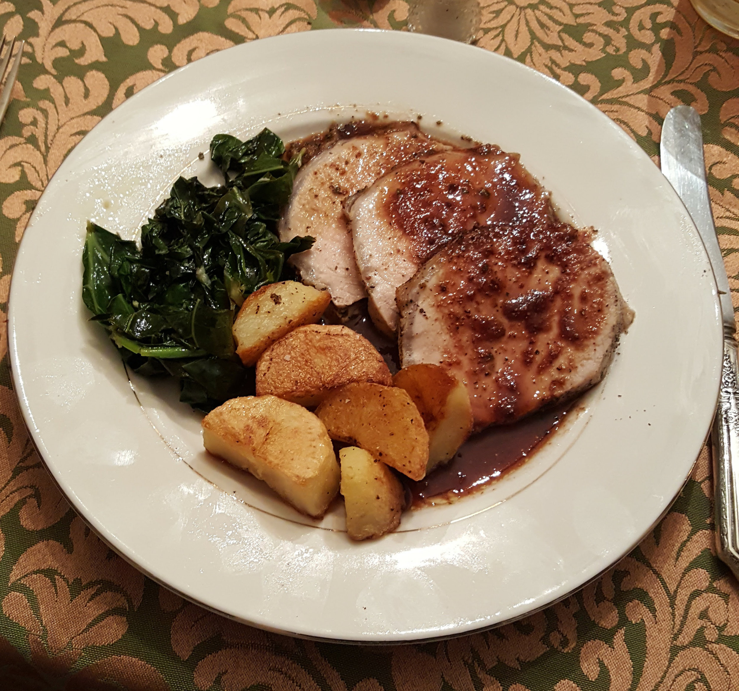Pork loin with port and fig reduction, roasted potatoes, suateed kale