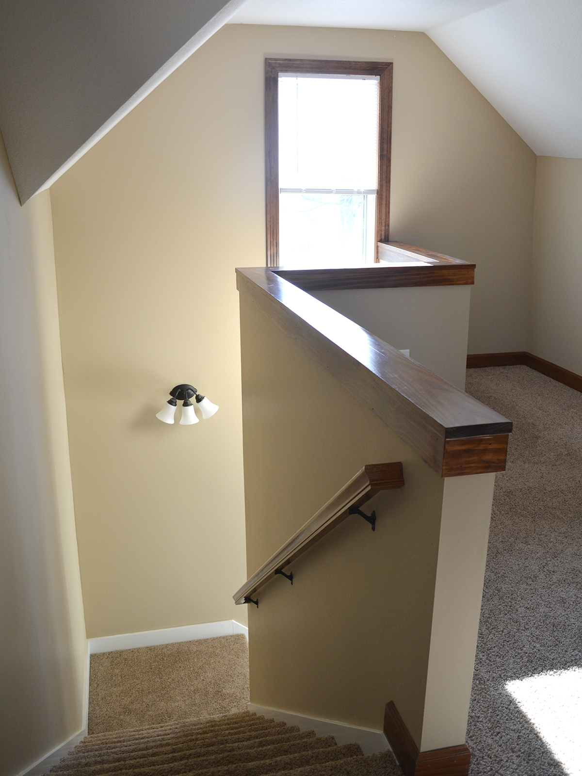 AFTER: Brand new turning stair case in the middle of the house with landing.