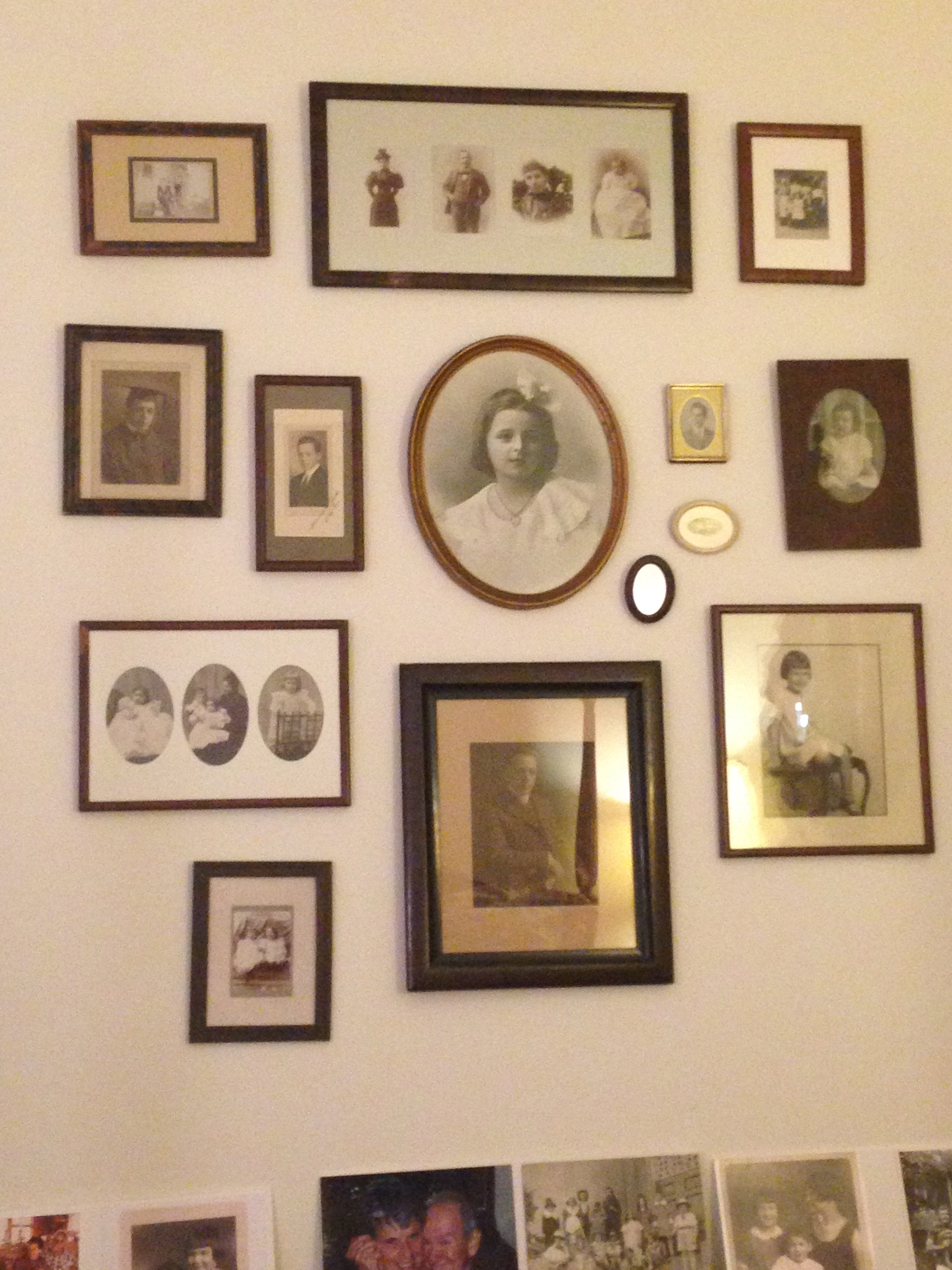 Family photos that hang across from my grandmother's bed.