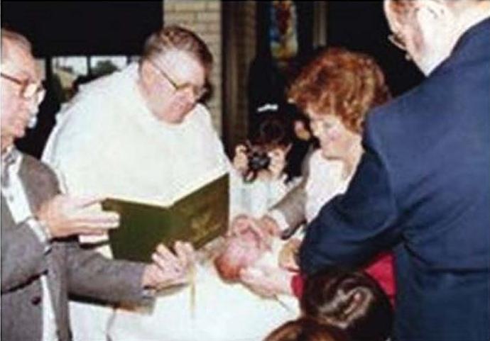 Br. James Martin's baptism by Fr. Albert Coburn, O.P