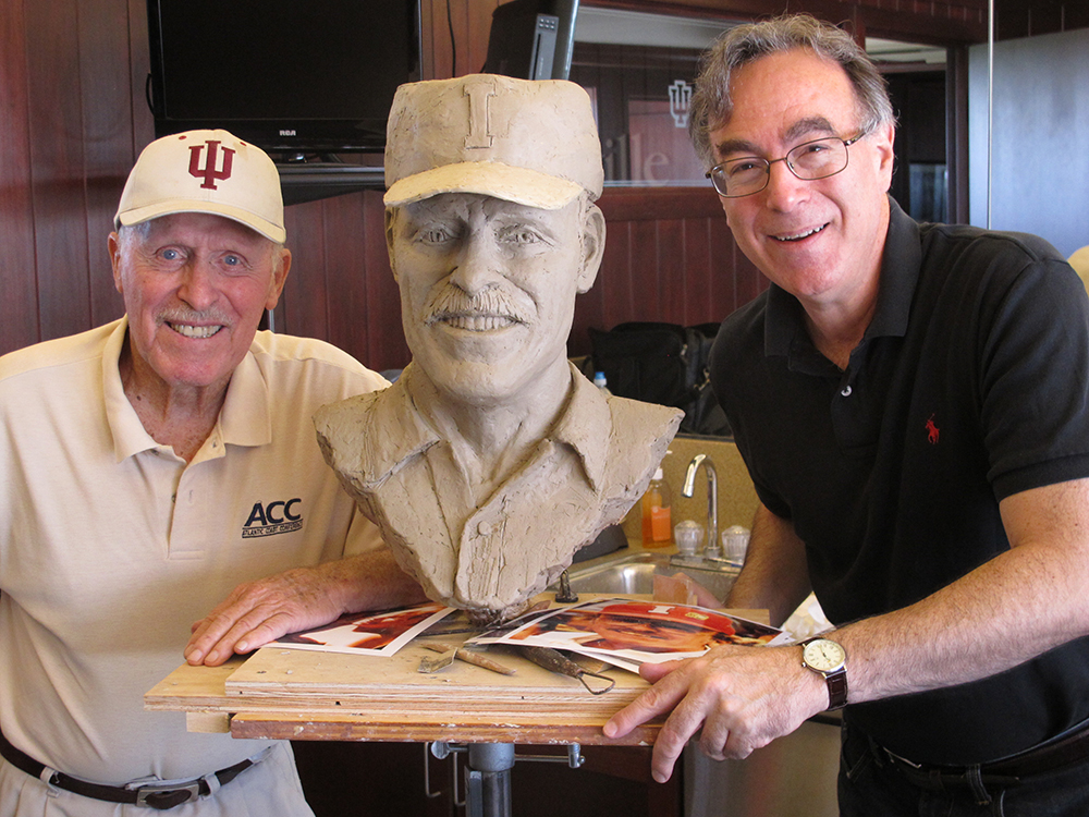 Hobie Billingsley with sculptor Marc Mellon and in process portrait bust of Hobie as he looked during his coaching days.