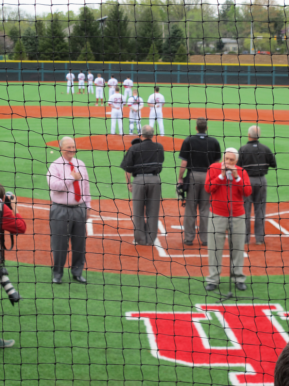 Legendary Dodger Carl Erskine leads the crowd at Bart Kaufman Field in the National Anthem.