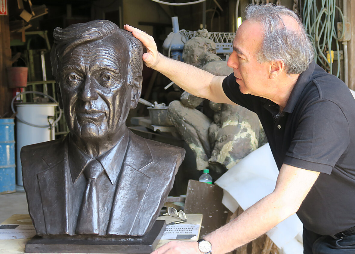 At the foundry, Marc inspecting the fine detailing of the Elie Wiesel Plaza bronze.