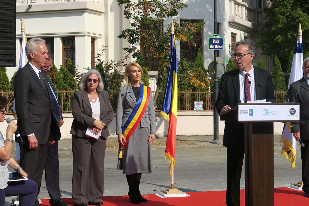 Marc delivering remarks in tribute to Elie Wiesel at the dedication. Pictured left to right: Mayor of Bucharest Gabriela Firea, Israeli Ambassador to Romania Tamar Samash, and US Ambassador to Romania Hans Klemm.