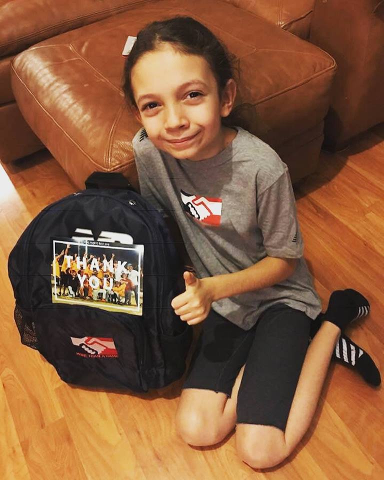 Maddie with her new MTAG backpack!