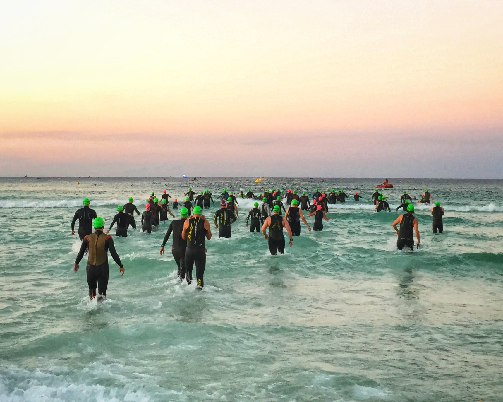 Iron Man athletes heading out into the ocean for the 2.4 mile swim