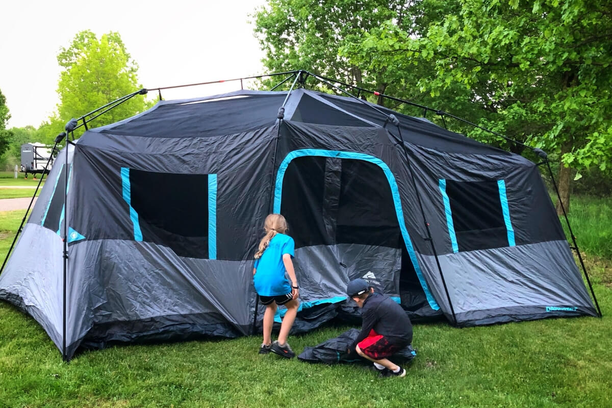 The kids helping us set up the tent.