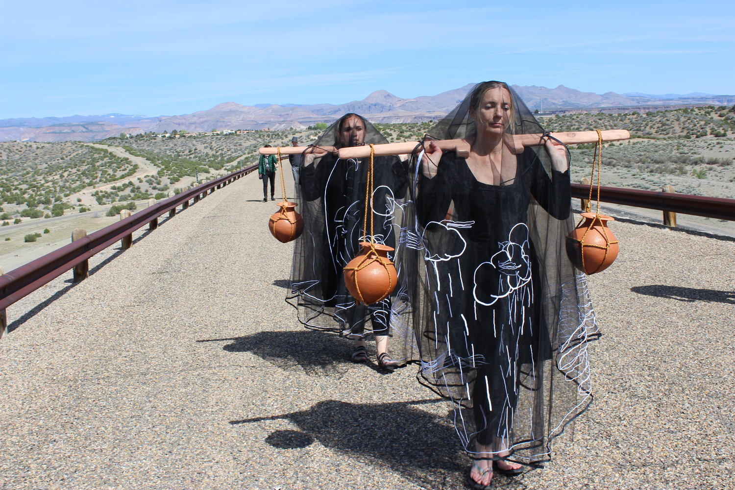 Walking Cochiti Dam, 2017 - a performative work created in partnership with community members of the Cochiti Pueblo, articulating the complexities of dam building on reservation lands in the USA, as part of the Reclamation Act of 1902 and 1960's Flood Control Act. The controversial Cochiti Dam was built in 1975 on the most sacred mountain and burial site in Cochiti Pueblo. The lake silt bed is now contaminated with waste plutonium washed down the Rio Grande from Los Alamos 'Atomic City', where the US government research programme, 'The Manhattan Project' produced the first atomic bombs between 1942 – 45.    In recognition of water as a living body, walking in this performance brings into focus the injured landscape of human interventions into sacred natural bodies.