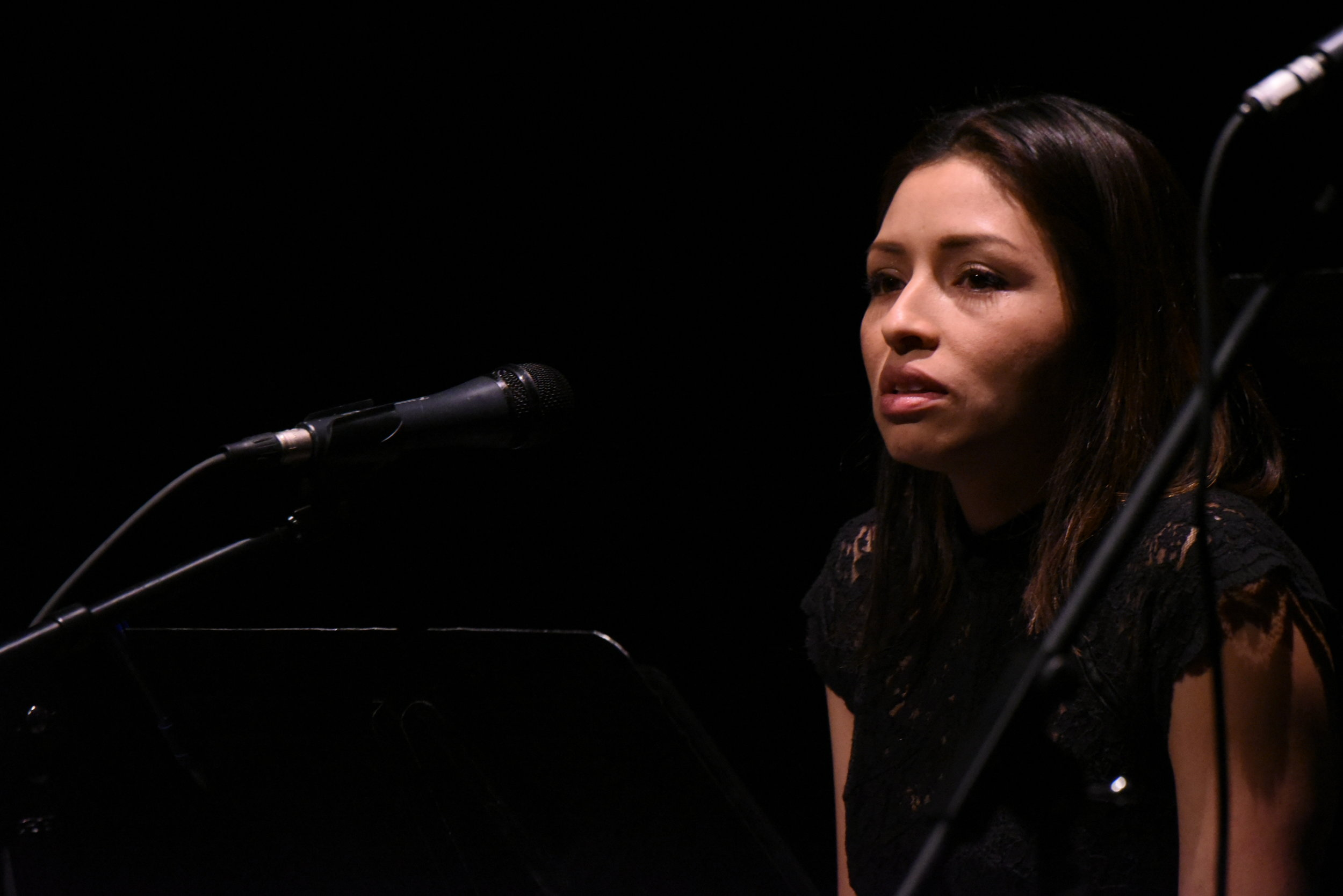 Laura Peniche shares her monologue on stage at a preview-private reading of Motus Theater's new UnDocuMonologues in Boulder, Colorado. Photo by Michael Ensminger.