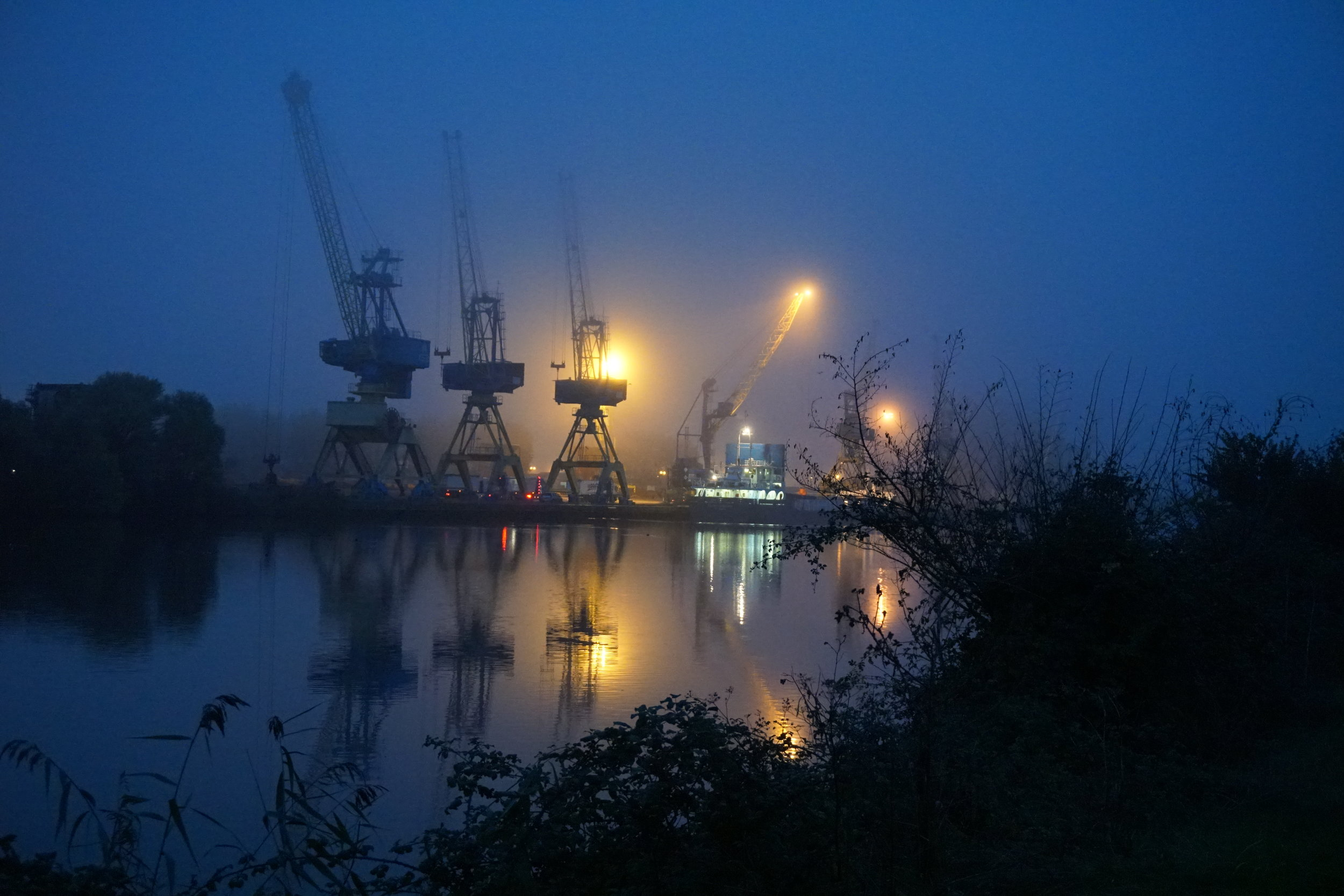 The early morning mist on the canal leading to Caen