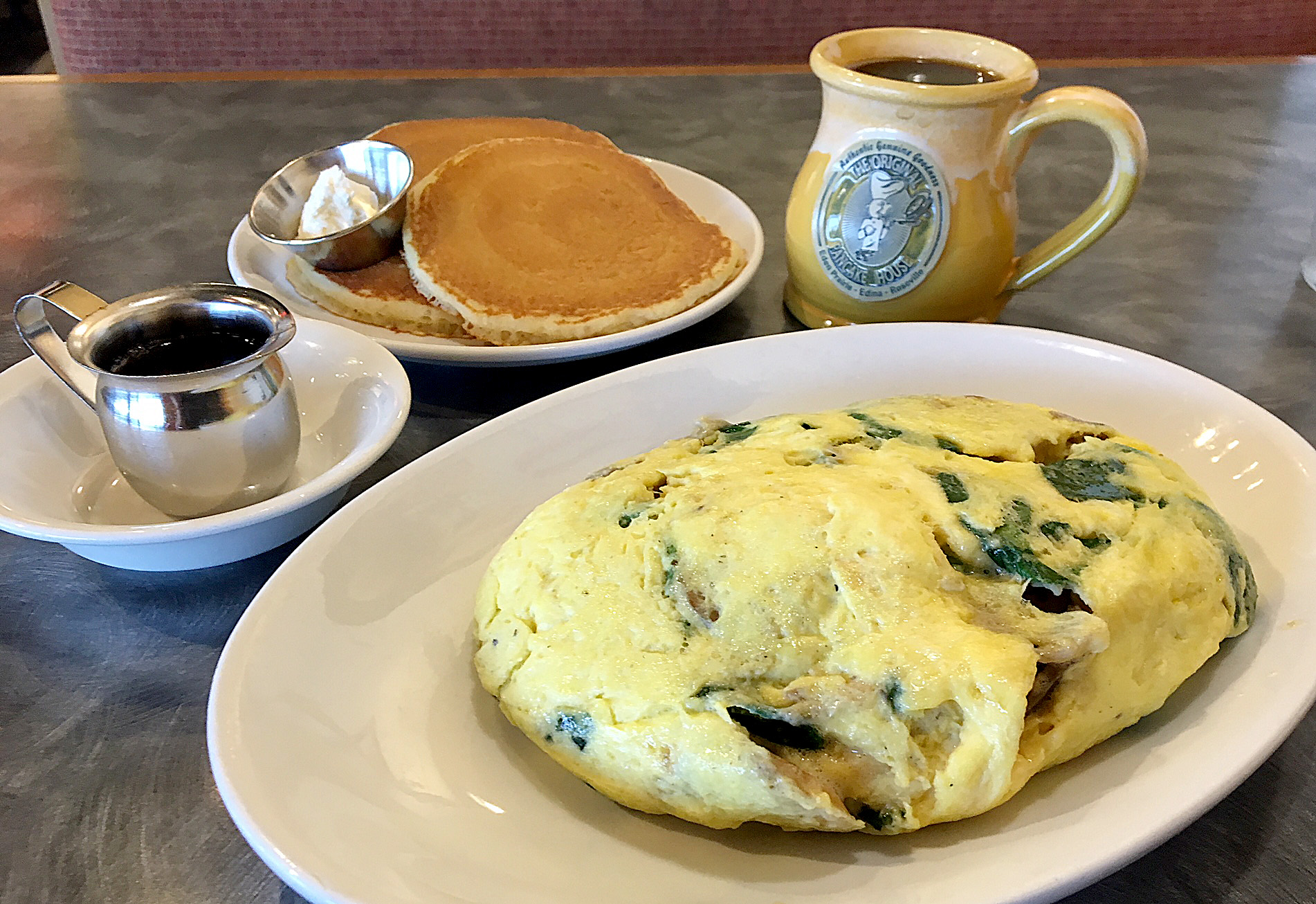 I woke up early the next morning, so I asked my old buddy Trip Advisor to find me the best local breakfast spot. I ended up with this soufflé omelet and pancakes. I'm still full.