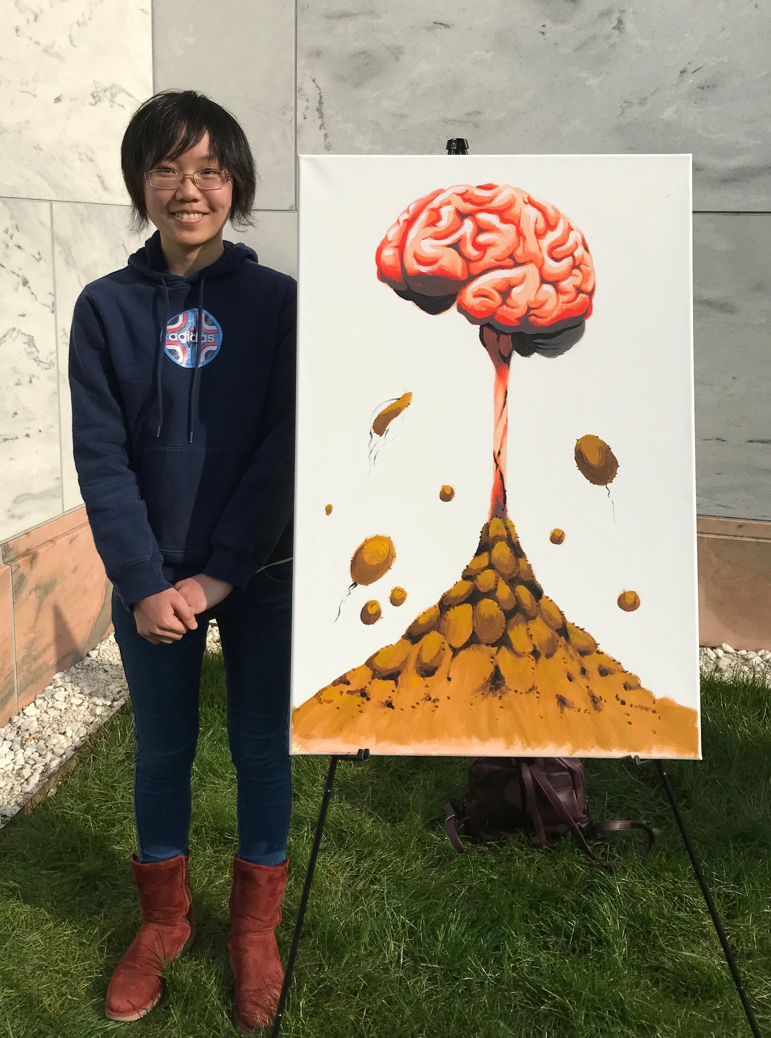 "Yibo Zhao and her piece ""Brain Mushroom"" inspired by the research of Madeleine Cohen."
