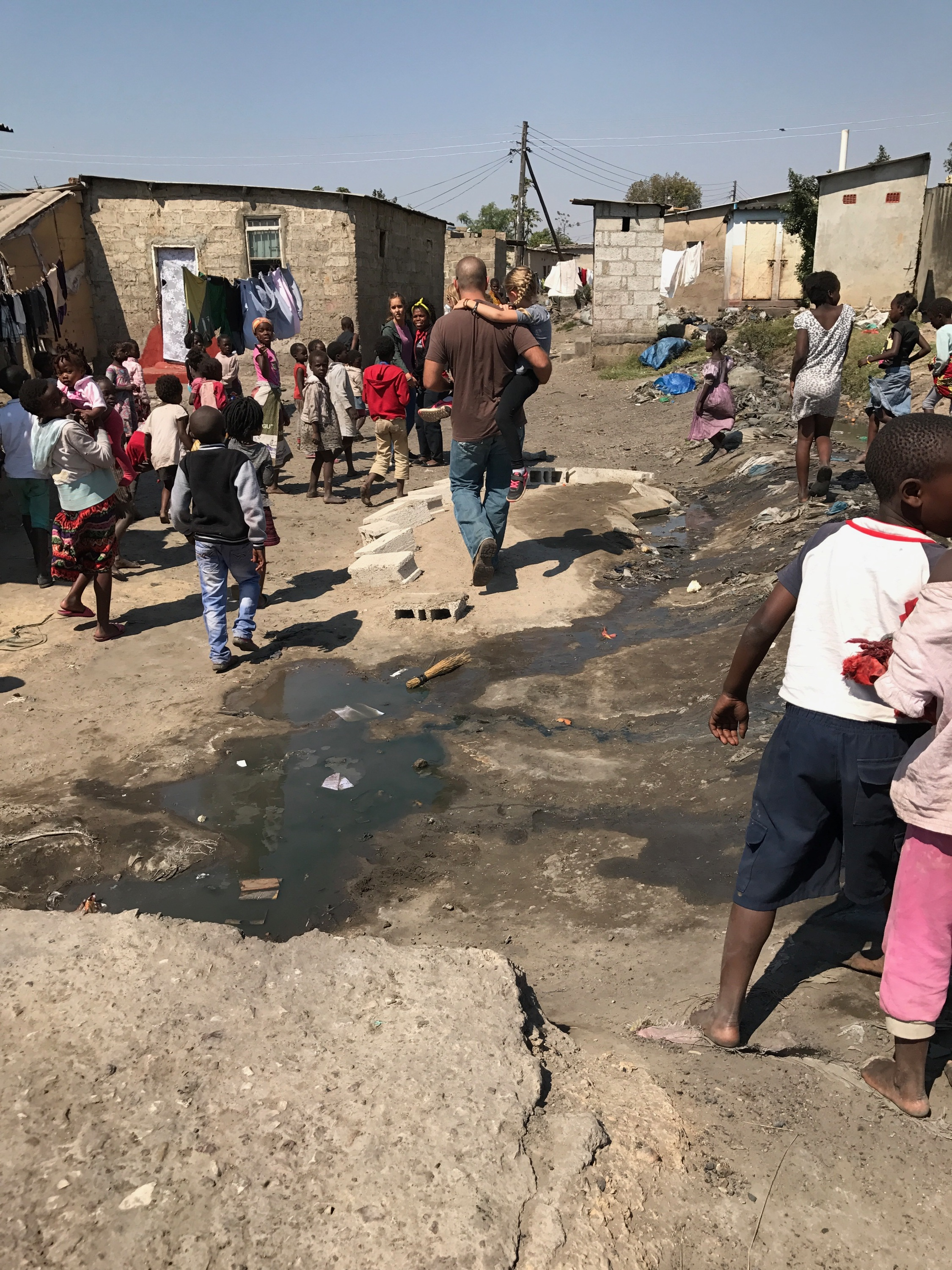 Walking through Chaisa, one of the many compounds in Lusaka that Family Legacy is rescuing children from.