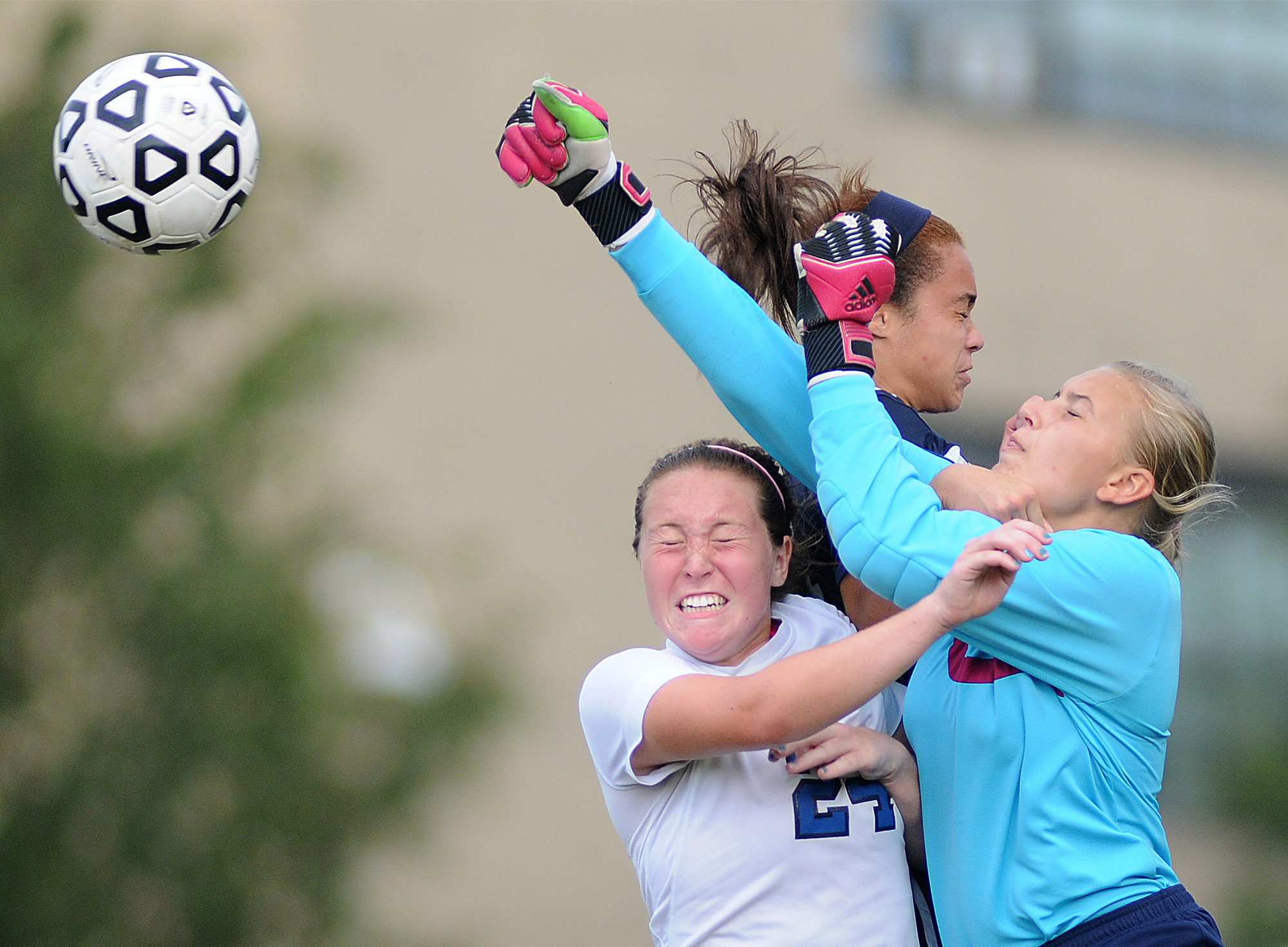 Cardinal O'Hara goal keeper Carrie Zamonski (31) punches the ball away from teammate Alex Patrick (24) and Conwell-Egan's Bailey Brown (24) during their game at Conwell-Egan Catholic High School in Bristol Township on Thursday, Sept. 11, 2014.