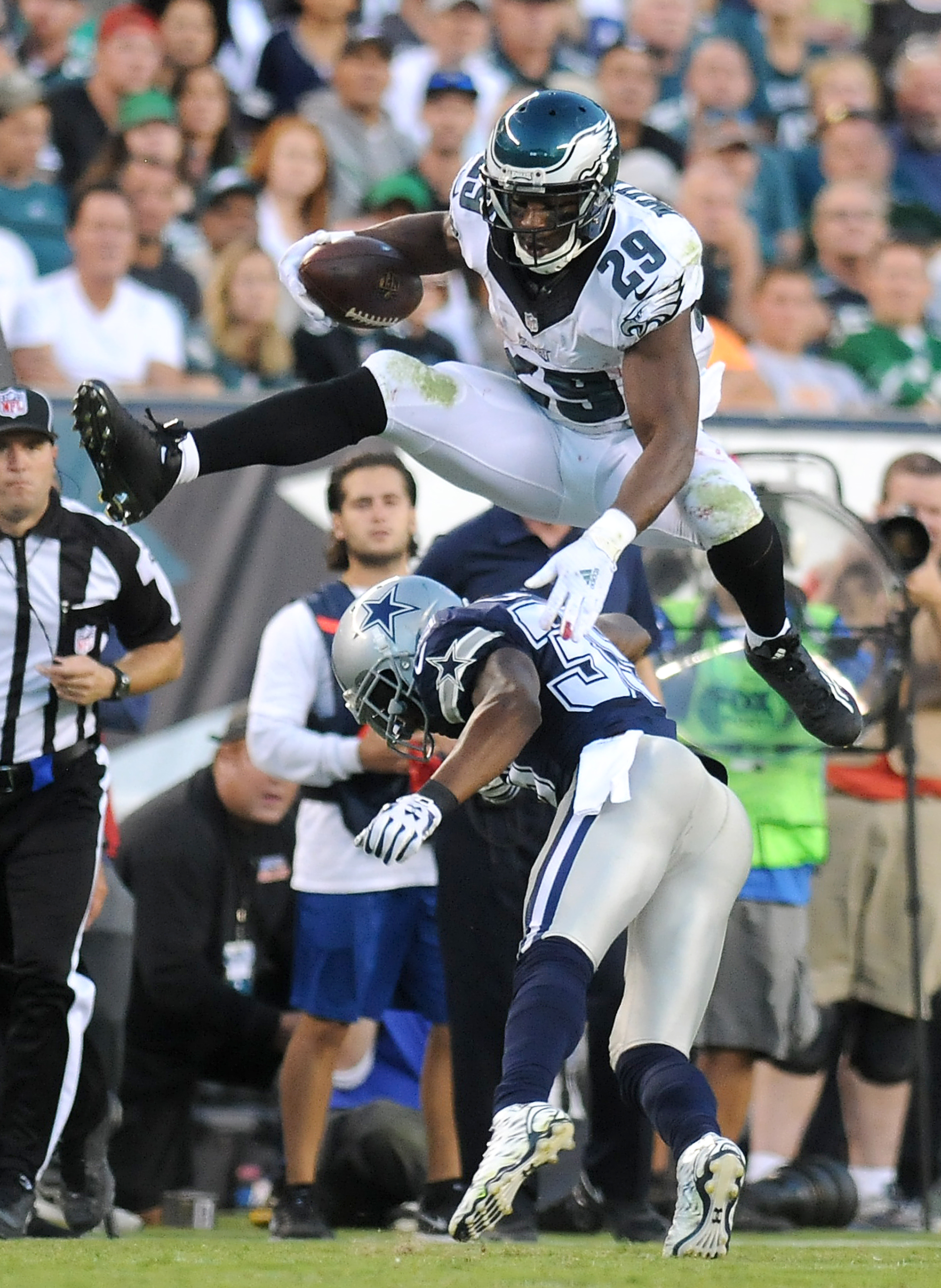 Philadelphia's DeMarco Murray (29) leaps over Dallas Cowboy Brandon Carr (39) during their game on Sunday, Sept. 20, 2015 at Lincoln Financial Field.