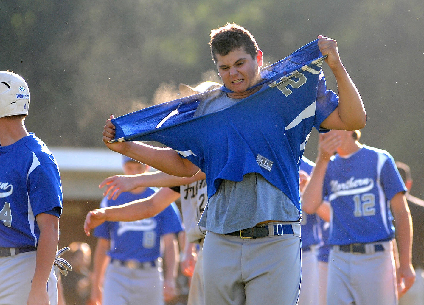 Northern Burlington's Zach Gakeler (32) rips his jersey immediately following their last out of the game, losing their state Group 3 semifinal game at Rider University in Lawrencville, NJ to Burlington Township on Tuesday, June 4, 2013.