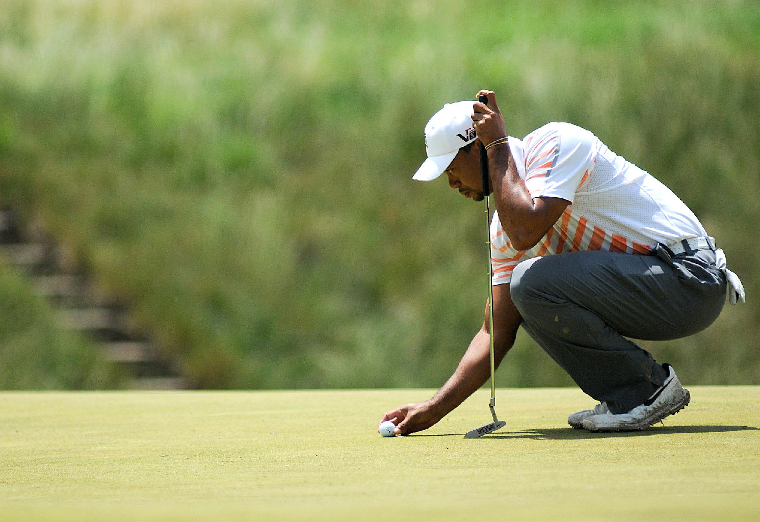 Tiger Woods prepares to put at Hole 17, a par of 3, during round 2 of the U.S. Open at Merion Golf Club on Friday, June 14, 2013.