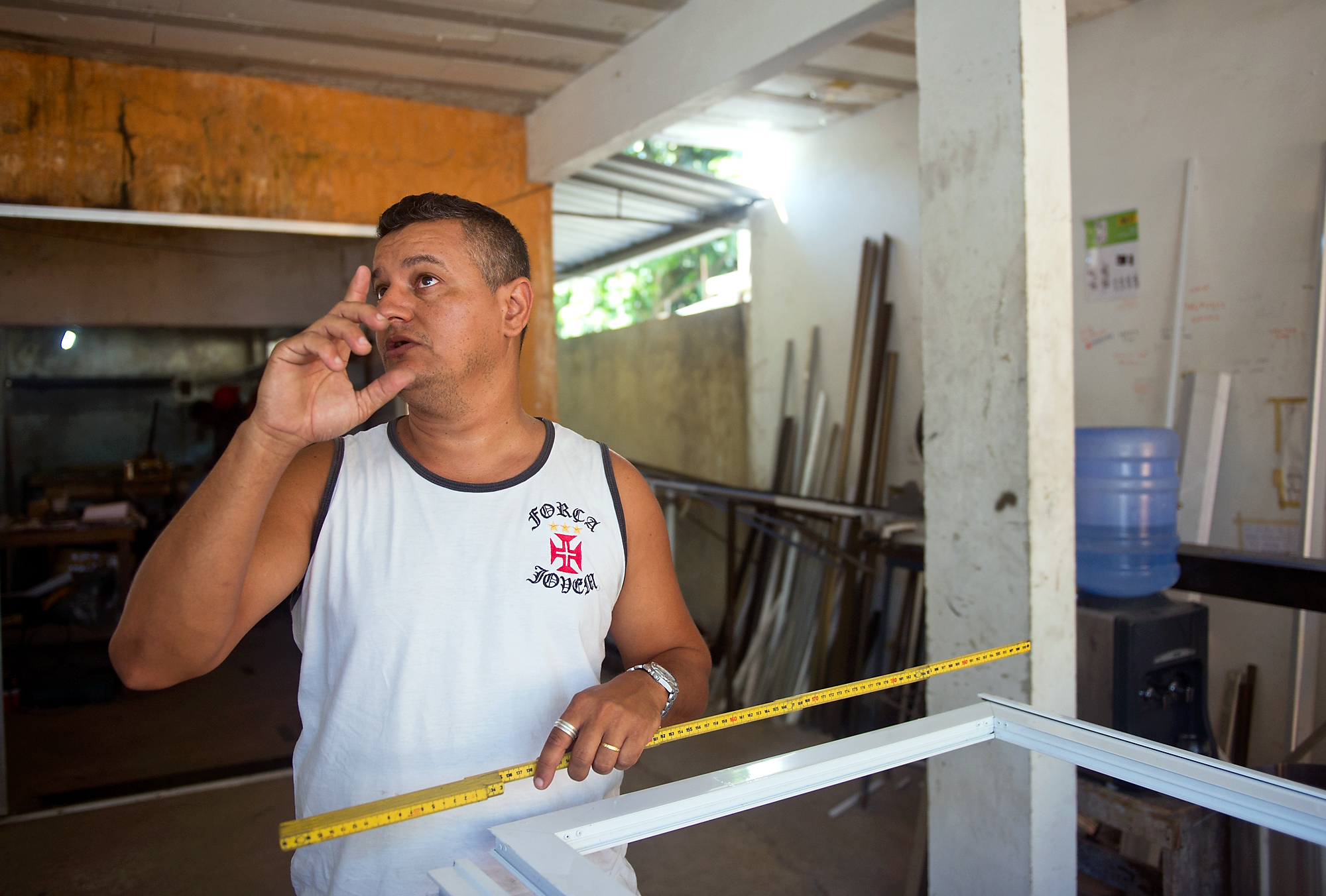 Antonio Carlos, who owns a construction business in Vila Autodromo, discusses his business dealing with the upcoming Olympics. Carlos said that if the government makes him move further away, no one will hire him.