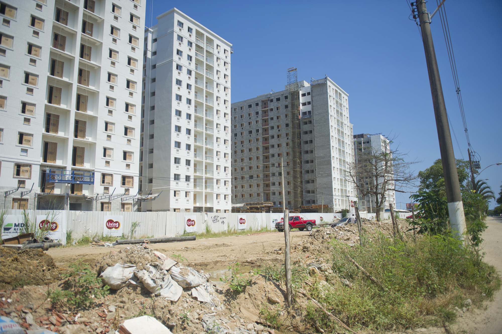 Construction in an area near Brito's home includes both low-end and high-end condominium development.