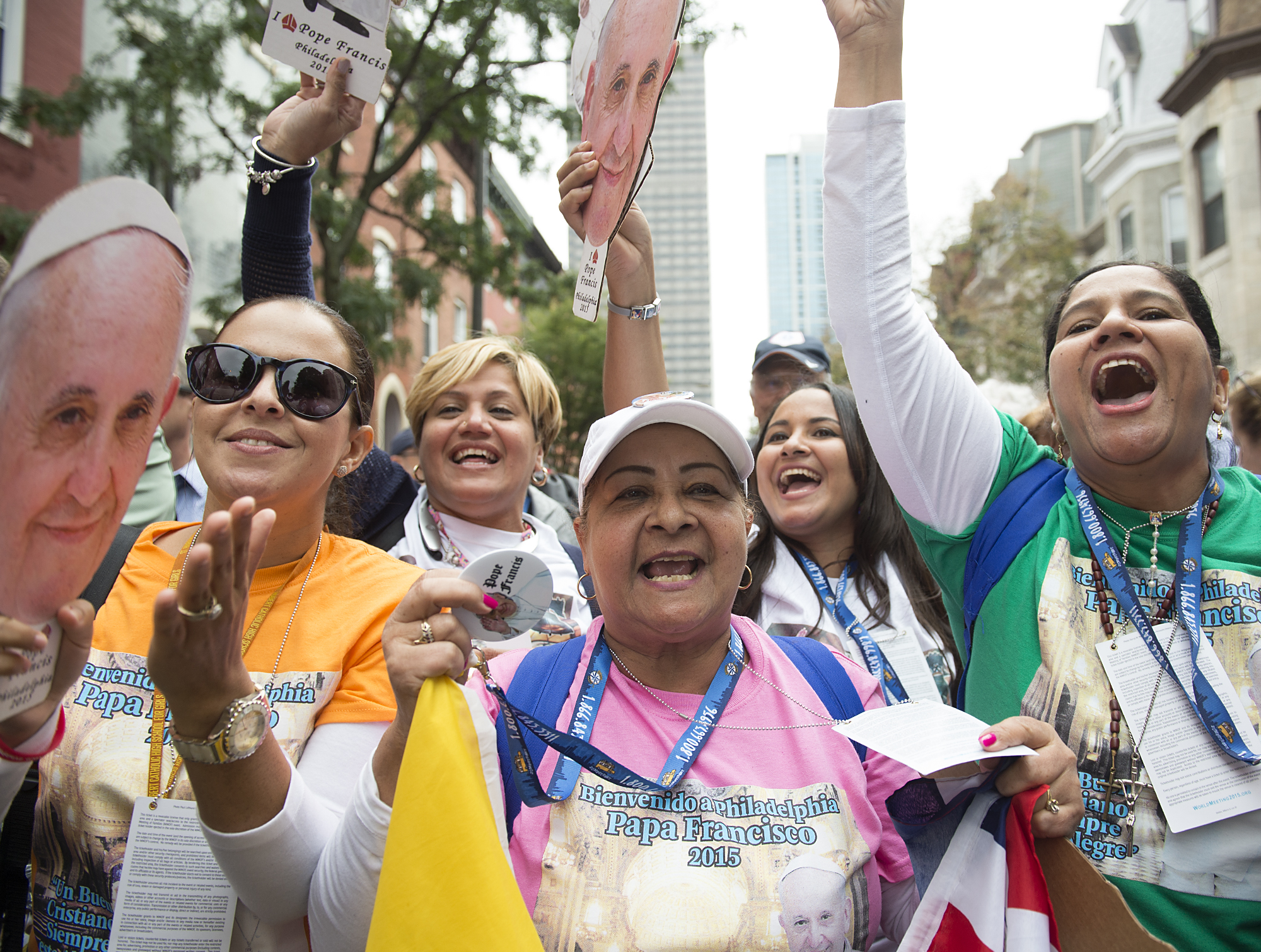 "Maria Rodriguez of the Dominican Republic sings with her group and chants ""El Papa esta presente,"" while waiting to see Pope Francis' Mass on the Ben Franklin Parkway on September 27, 2015. Lines were multiple hours-long waits with no bathrooms or handicap entrances along the route."