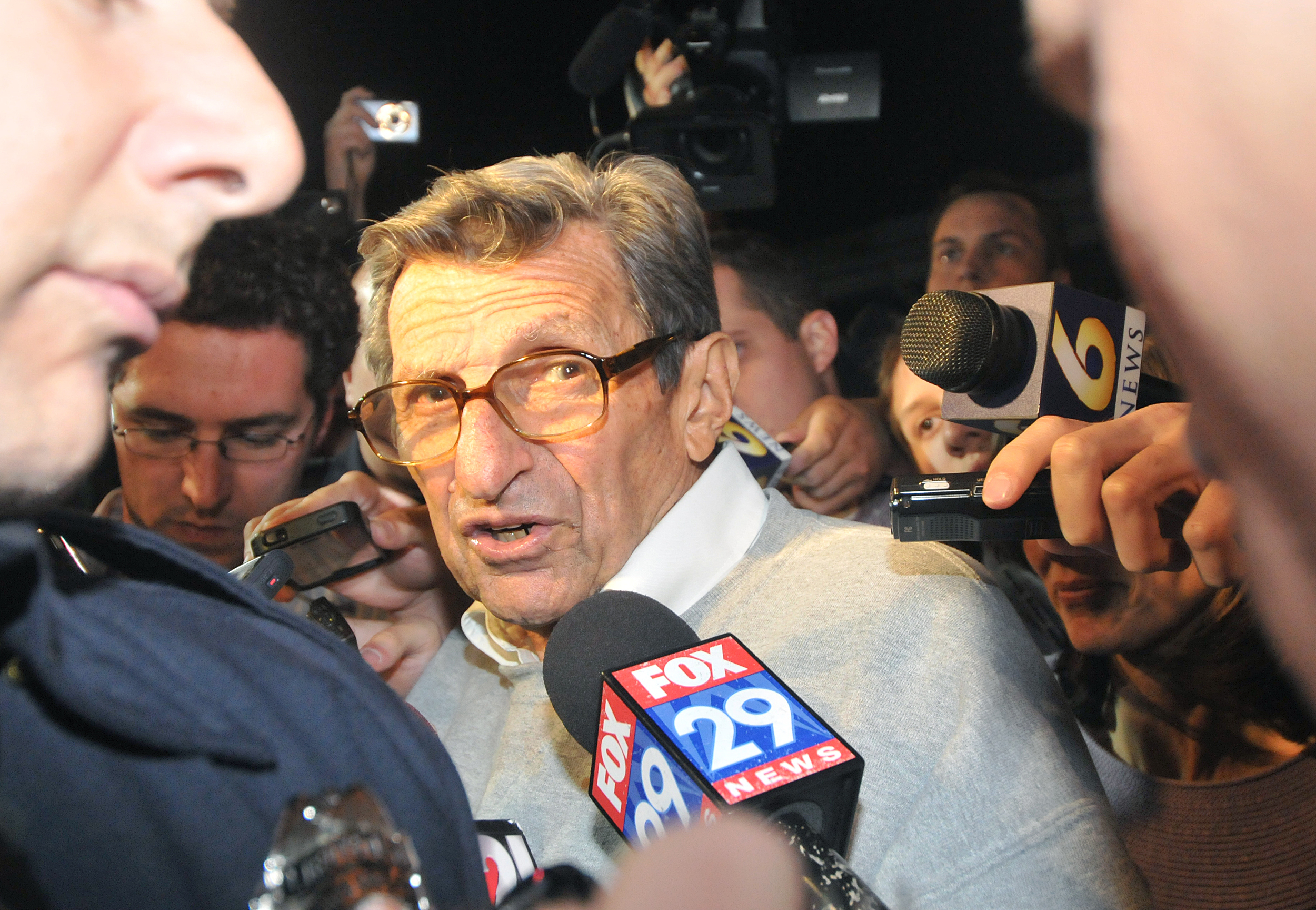 Head coach Joe Paterno speaks outside of his home in State College on Tuesday night to members of the media. A group of around 300 students gathered in support of Paterno, held signs, and sang the Alma Mater.