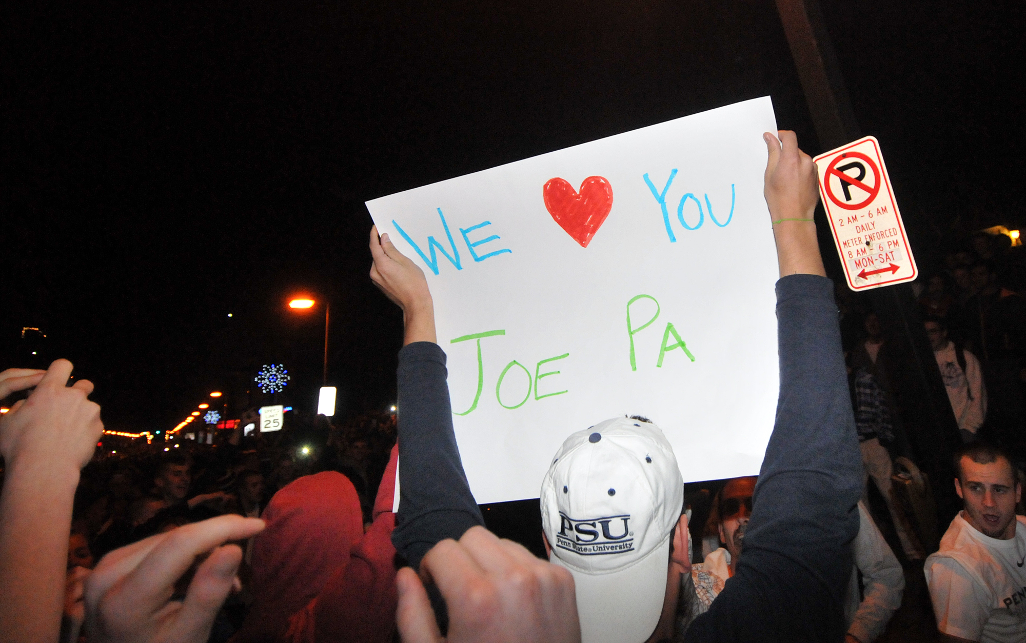 A student holds up a sign during the riot in Beaver Canyon in downtown State College on Wednesday night.