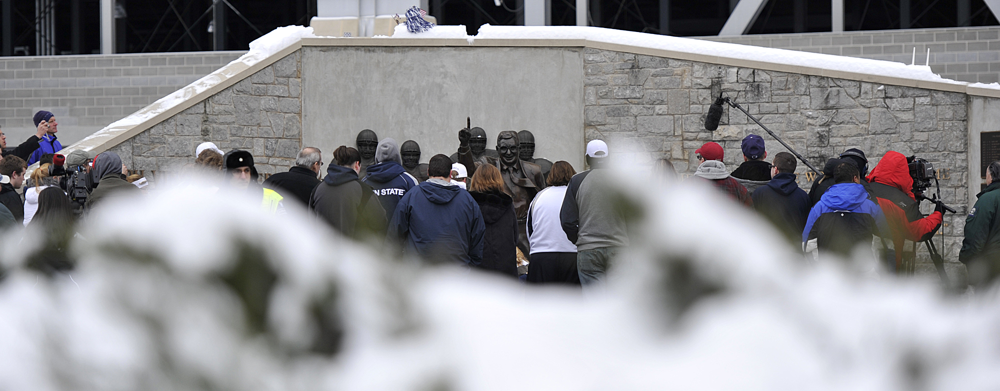 Crowds gather around the Joe Paterno Statue on Sunday, Jan. 22, 2012 after learning of his death due to complications with lung cancer.