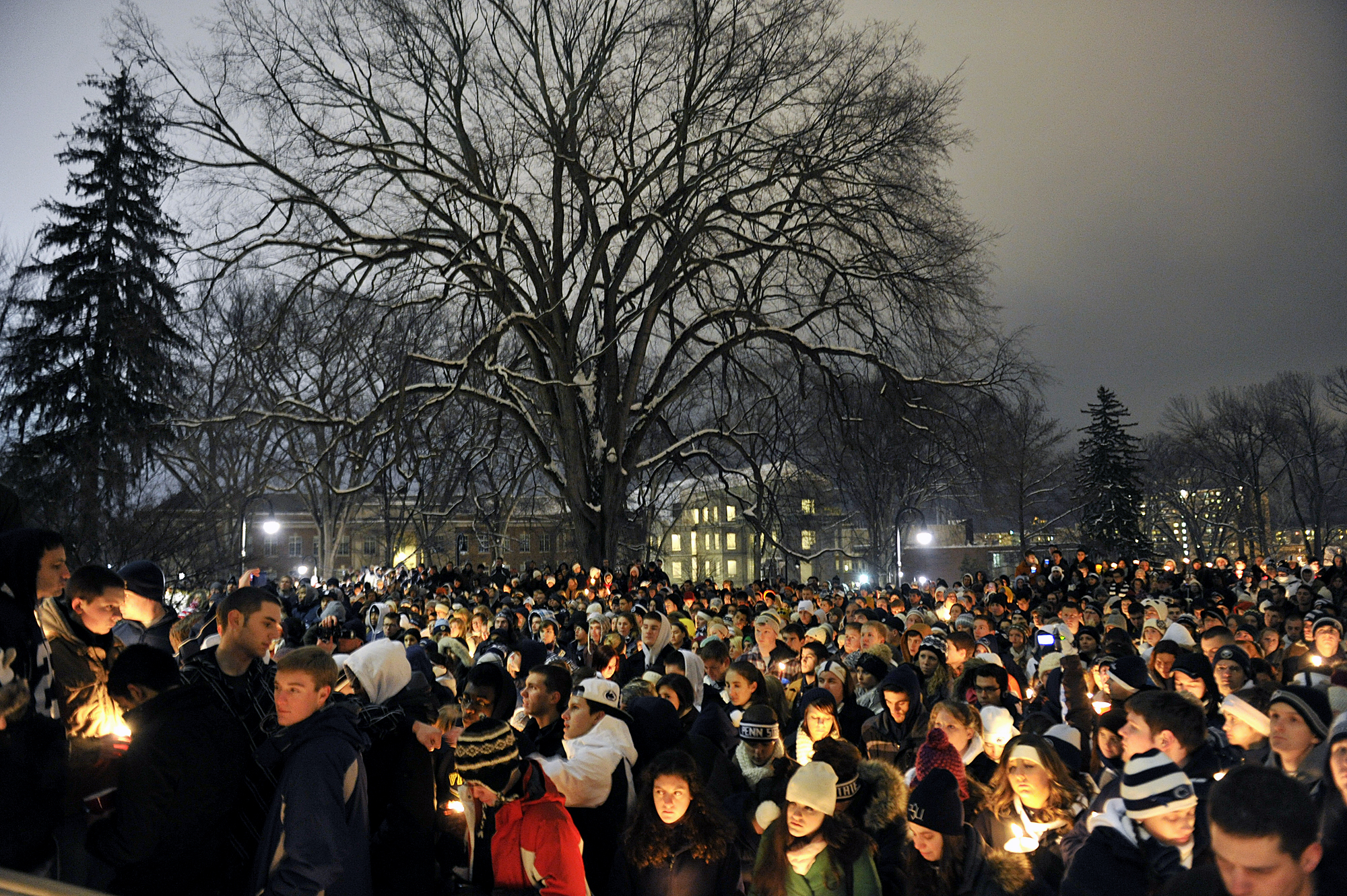 Students and community members gather on the Old Main lawn on Sunday, Jan. 22, 2012 for a vigil honoring Joe Paterno.