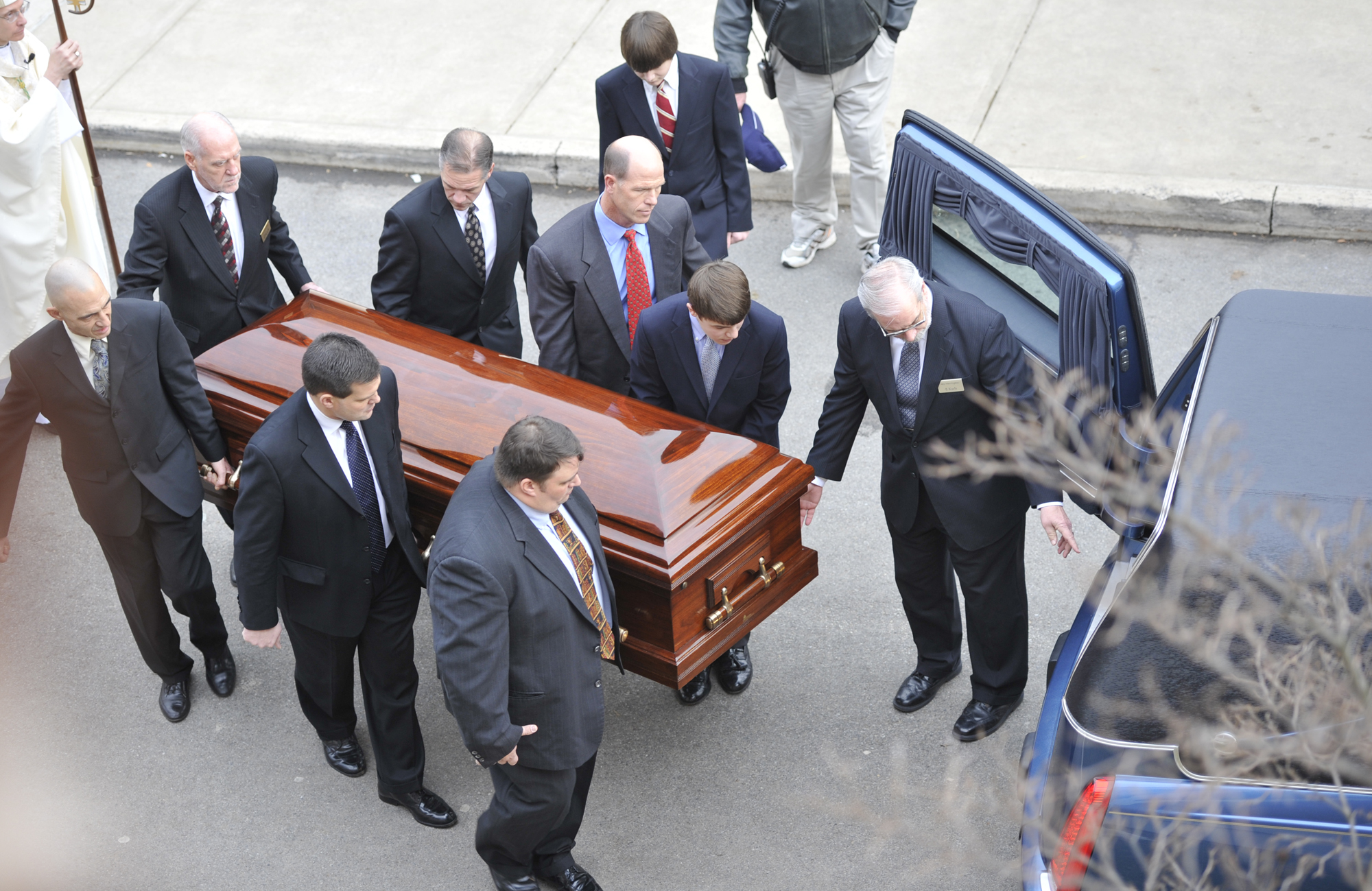 Pallbearers carry the casket of former head football coach Joe Paterno to the hearse parked outside of the Pasquerilla Spiritual Center on Wednesday, Jan. 25, 2012 before the funeral procession around State College.