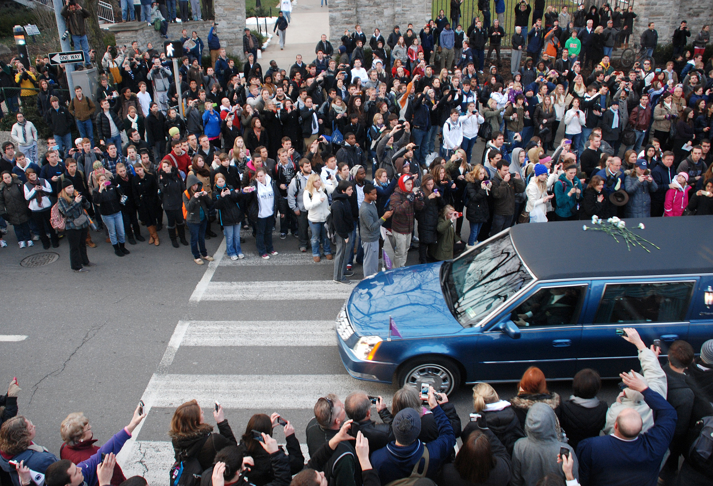 A hearse carrying the casket of Joe Paterno drives by the Allen Street gates on Wednesday, Jan. 25, 2011 during the funeral procession from the Pasquerilla Spiritual Center to a private burial.
