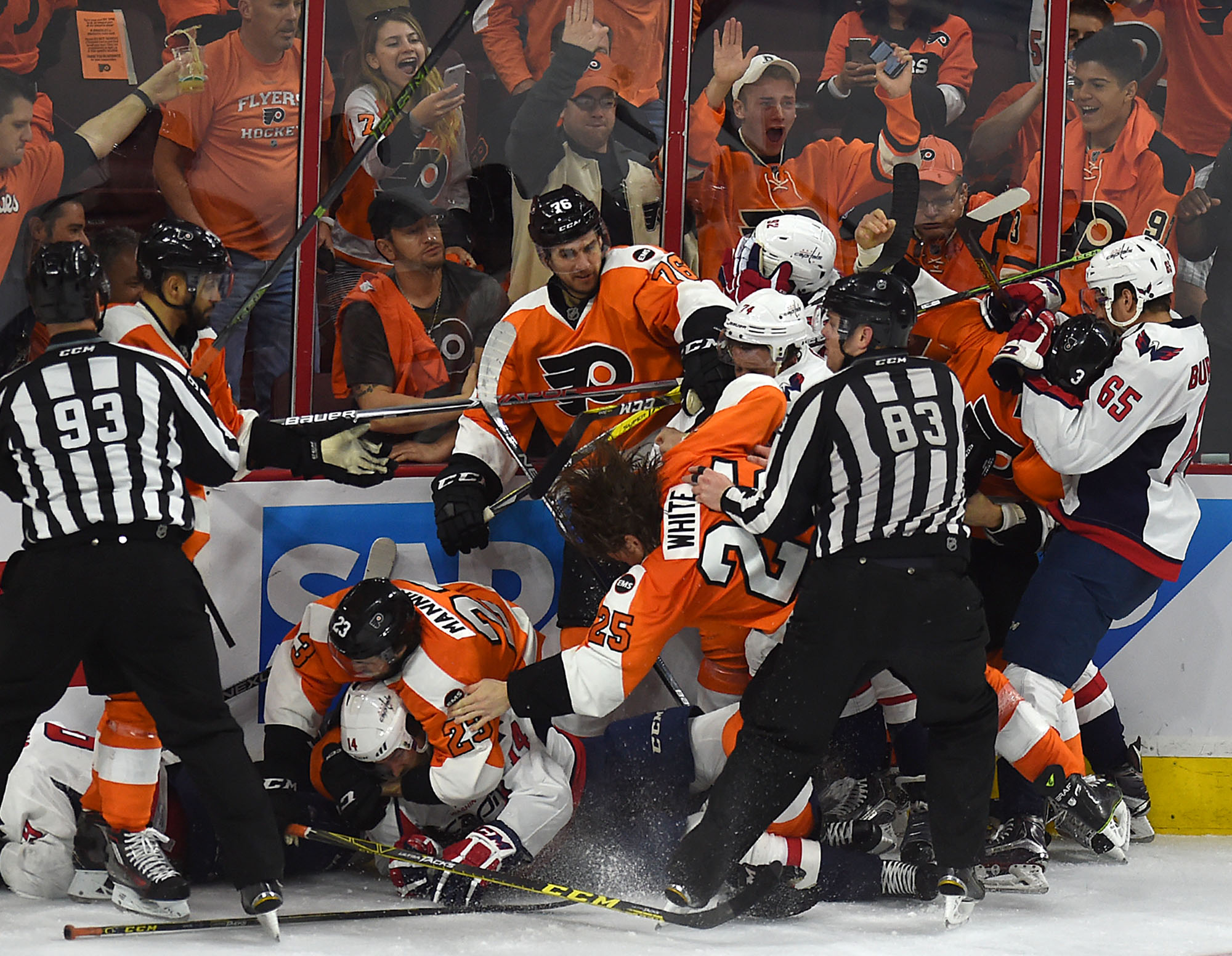 Flyers player Ryan White (25) falls down in the middle of a huge pile of fighting players from both teams during their playoff game against the Capitals at The Wells Fargo Center on Monday, April 18, 2016. The Flyers lost 6-1, but went on to win two more games against the Caps in their seven-game series.