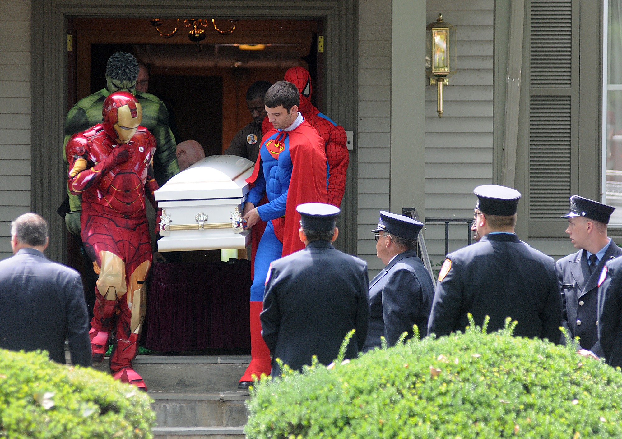 The casket of 5-yr-old Franky Talley is escorted from the Hooper Funeral Home on W. Trenton Avenue in Morrisville by pallbearers dressed as superheroes to a mass at St. John the Evangelist in Morrisville before a burial at the Holy Trinity Cemetery in Lower Makefield on Monday, June 30, 2014. Franky lost his battle to a rare brain cancer the week prior.
