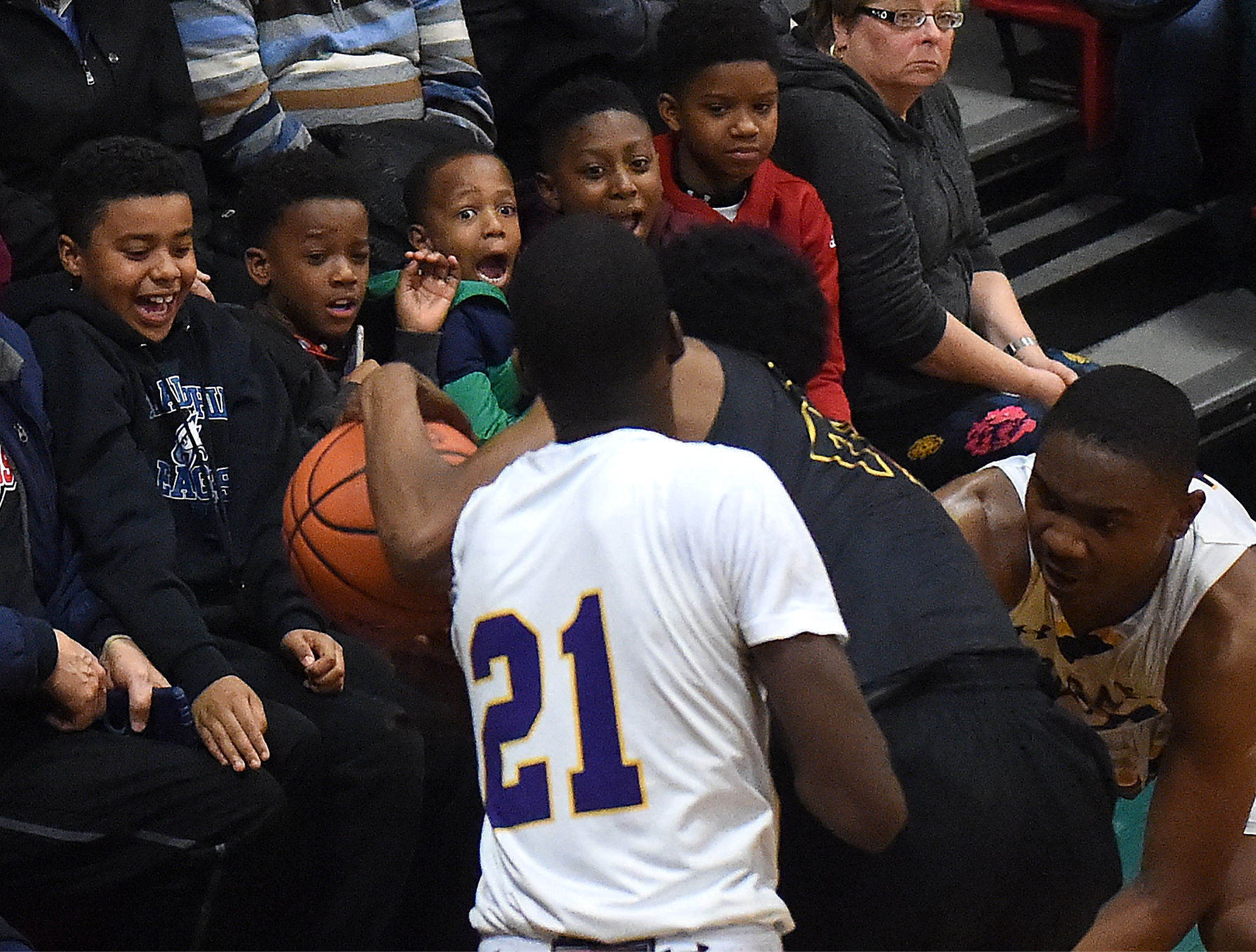 A group of boys react to players losing control of the ball in front of them during the District 12 AAAAA title game of Archbishop Wood against Martin Luther King High School at Father Judge High School in Northeast Philadelphia on Friday, March 3, 2017. Wood won the game 87-51.