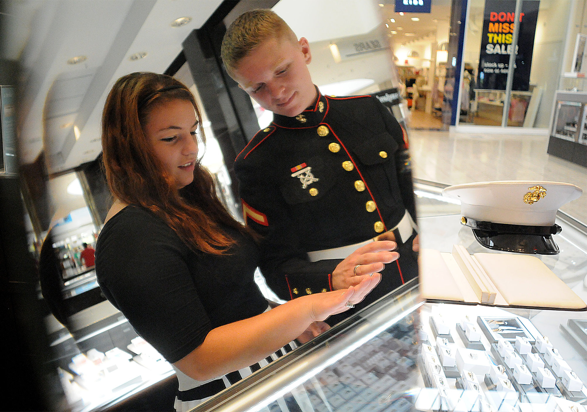 Dee Hubay and fiancé Dan Bryan look for wedding bands at Littman Jewelers in the Oxford Valley Mall on Monday, July 20, 2015.