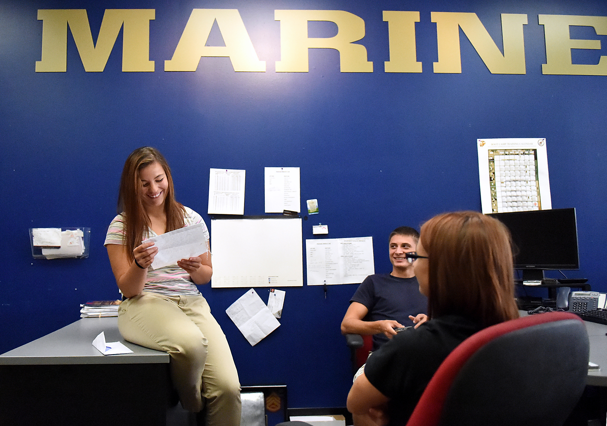 Dee Hubay reads her first letter from a friend at the US Marine Corps Recruiting station on Cottman Avenue in Philadelphia before leaving for boot camp at on Sunday, August 23, 2015.
