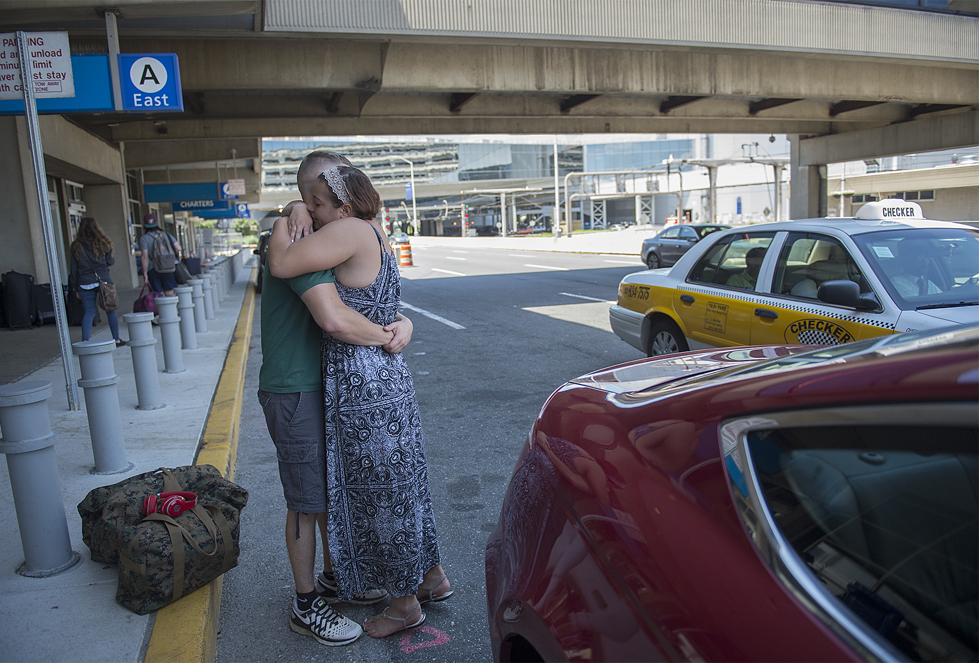 Dee Hubay hugs fiancé Dan Bryan while dropping him off at the Philadelphia International Airport to return to his MOS school on Wednesday, July 22, 2015 after a short break returning to Middletown Township.