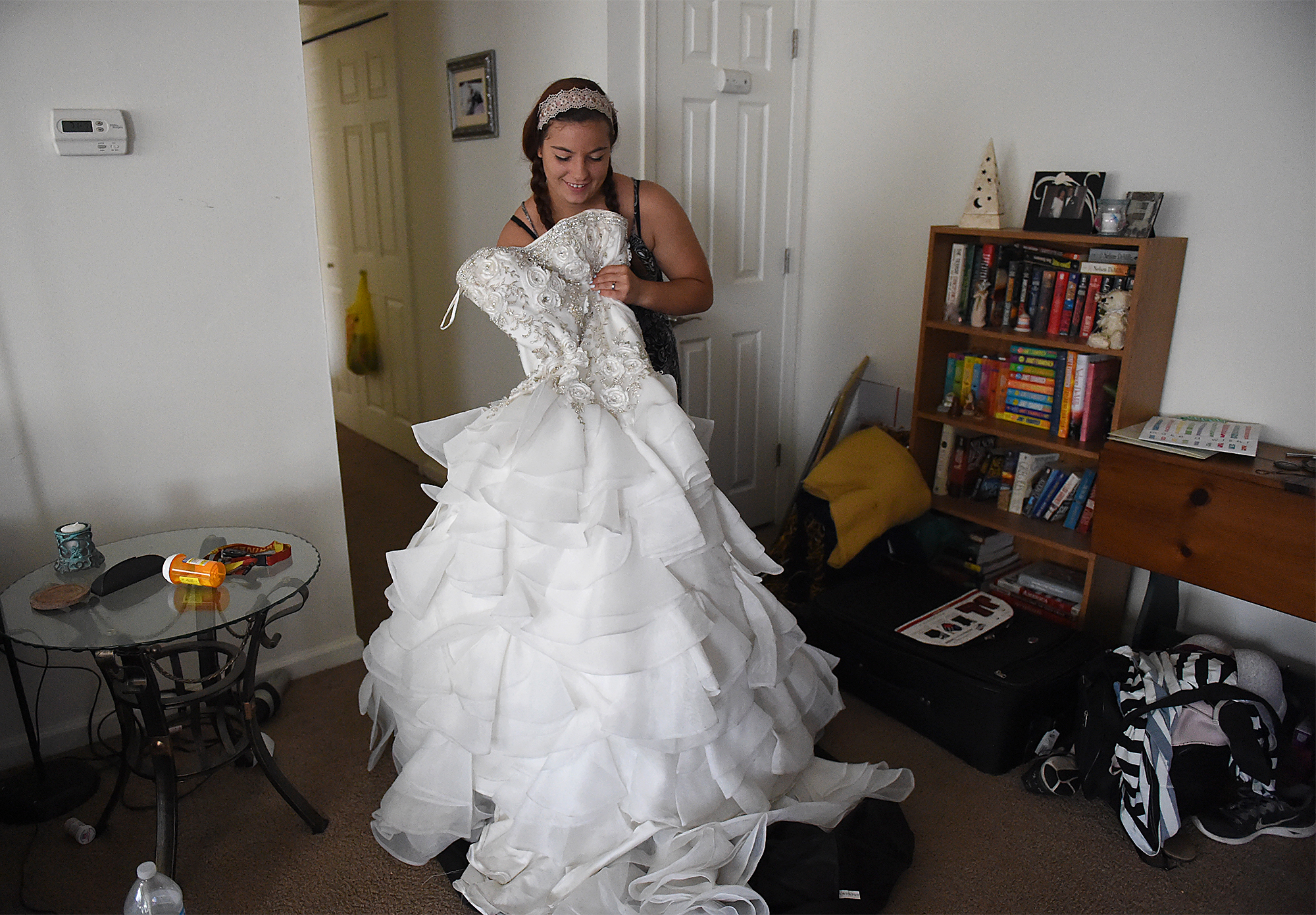 Dee Hubay shows off her wedding dress at her mom's apartment in Northeast Philadelphia after dropping off fiancé Dan Bryan at the Philadelphia International Airport to return to his MOS school on Wednesday, July 22, 2015.  The dress was given to her by a former classmate, who wore it as a prom dress. According to Hubay, the classmate is also now in a Delayed Entry Program for the Marine Corps, which is what she did as well.